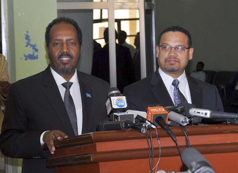 Somali President Hassan Sheikh Mohamud, left, and US Congressman Keith Ellison give a joint press conference at Mogadishu airport,  Tuesday Feb. 19, 2013.  Ellison said Tuesday that his visit to Mogadishu fulfills a request from his constituents with ties to Somalia, as Minnesota has one of the largest populations of Somali-Americans in the U.S. (AP Photo)