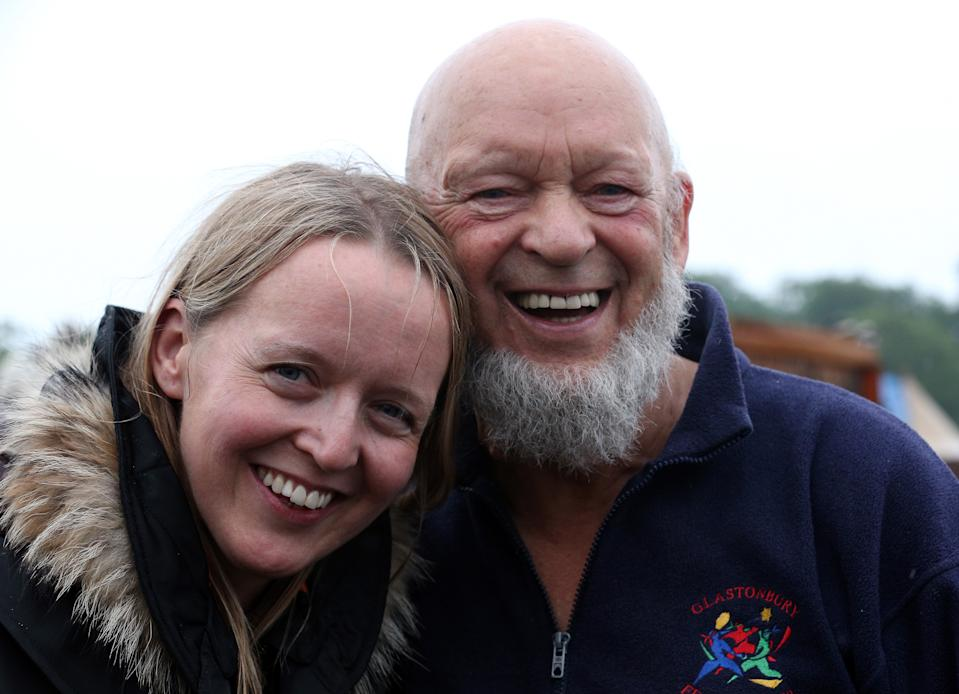 GLASTONBURY, ENGLAND - JUNE 27:  Festival founder Michael Eavis and his daughter Emily pose for a photograph at the Glastonbury Festival of Contemporary Performing Arts site at Worthy Farm, Pilton on June 27, 2013 near Glastonbury, England. Gates opened on Wednesday at the Somerset Diary Farm that will be playing host to one of the largest music festivals in the world and this year features headline acts Artic Monkeys, Mumford and Sons and the Rolling Stones. Tickets to the event which is now in its 43rd year sold out in minutes and that was before any of the headline acts had been confirmed. The festival, which started in 1970 when several hundred hippies paid 1 GBP to watch Marc Bolan, now attracts more than 175,000 people over five days.  (Photo by Matt Cardy/Getty Images)