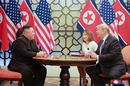 North Korea's leader Kim Jong Un and U.S. President Donald Trump talk during the second North Korea-U.S. summit in Hanoi, Vietnam, in this photo released on March 1, 2019 by North Korea's Korean Central News Agency (KCNA). KCNA via REUTERS
