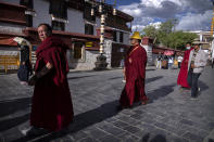 Monks circumambulate around the Jokhang Temple in Lhasa in western China's Tibet Autonomous Region, Tuesday, June 1, 2021, as seen during a government organized visit for foreign journalists. High-pressure tactics employed by China's ruling Communist Party appear to be finding success in separating Tibetans from their traditional Buddhist culture and the influence of the Dalai Lama. (AP Photo/Mark Schiefelbein)