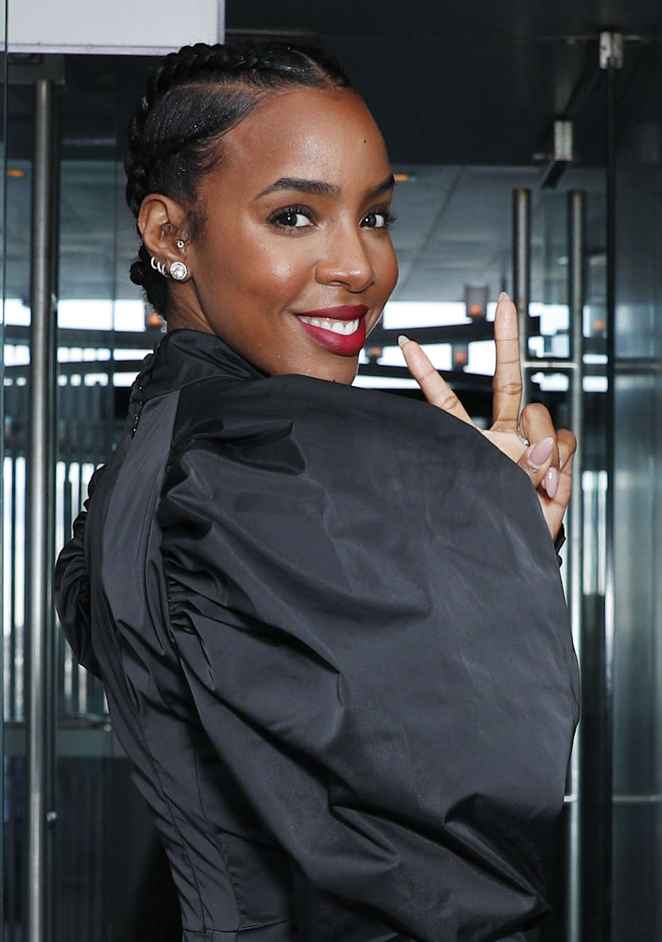 Sleek goddess braids keep the focus on your face. Kelly Rowland's hair is glam and low-maintenance at the same time.