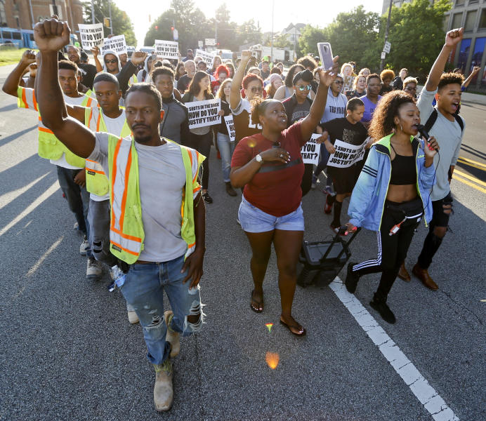 People start a protest march against the shooting death of Antwon Rose Jr. on Tuesday, June 26, 2018, in Pittsburgh. Rose was fatally shot by a police officer seconds after he fled a traffic stop June 19, in the suburb of East Pittsburgh. (AP Photo/Keith Srakocic)
