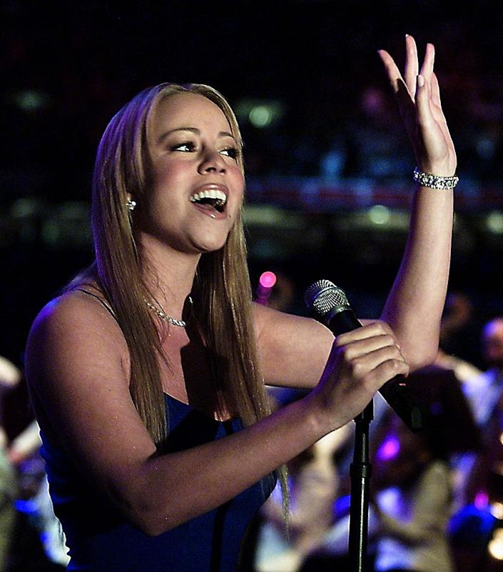 Singer Mariah Carey performs 'The National Anthem' on Feb. 3, 2002at the Louisiana Superdome before Super Bowl XXXVI in New Orleans, Louisiana. The St. Louis Rams and the New England Patriots playedfor the NFL championship.