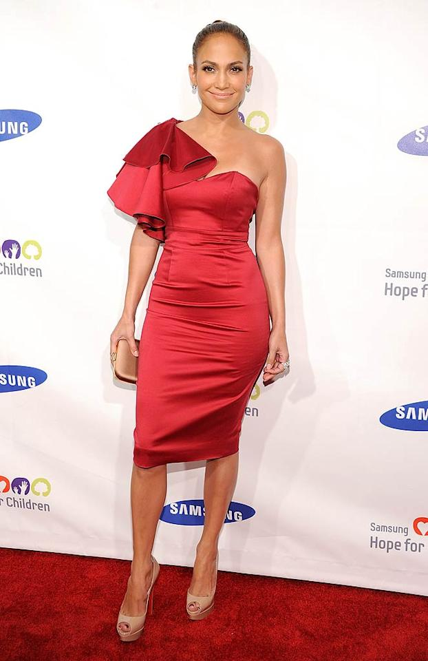 """Jennifer Lopez rarely wears bright red, but she looked absolutely radiant in the shade upon arriving at this year's Hope for Children Gala in a sleek and sophisticated Temperley London Fall 2011 dress. The multi-talented star's accessories included Stephen Webster baubles and nude Christian Louboutin platform peep-toes. Dimitrios Kambouris/<a href=""""http://www.wireimage.com"""" target=""""new"""">WireImage.com</a> - June 7, 2011"""