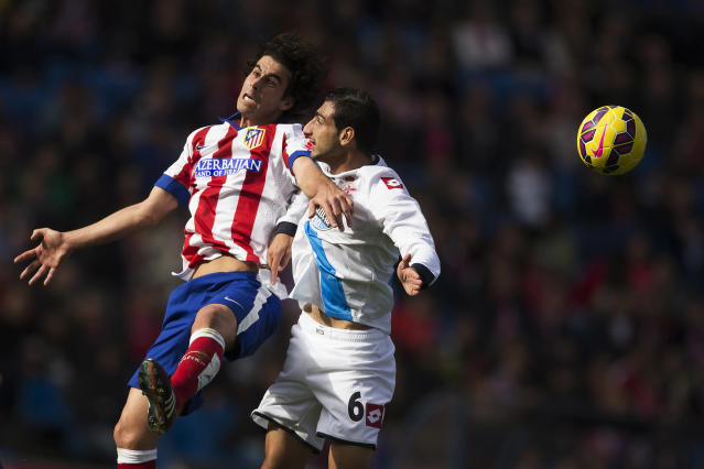 <p>Atlético Madrid's Tiago, left, in action with Deportivo Coruña's Jose Rodriguez during a soccer match at the Vicente Calderón Stadium in Madrid, Nov. 30, 2014. (AP Photo/Andres Kudacki) </p>