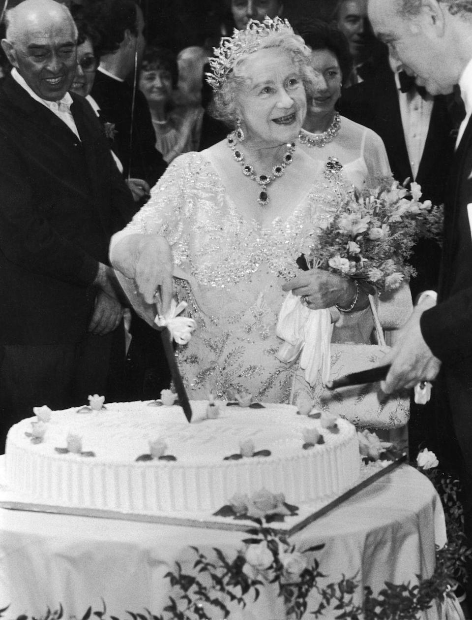 <p>On her 80th birthday, the Queen Mother cut into her cake at a party in Covent Garden. Other special festivities surrounding her celebration included a private dinner at Downing Street thrown by Prime Minister Thatcher and her husband. </p>