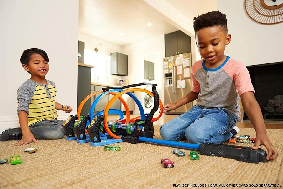 <p>There will never be a dull moment between your twins thanks to all the things they can do with their cars and this <span>Hot Wheels Corkscrew Crash Track with Motorized Boosters</span> ($46).</p>