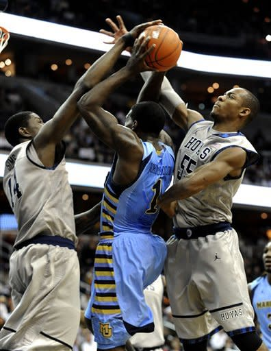 Georgetown's Henery Sims (14) blocks a shot by Marquette's Darius Johnson-Odom (1) as Georgetown's Jabril Trawick (55) defends during first half of their NCAA college basketball game, Wednesday, Jan. 4, 2012, in Washington. (AP Photo/Richard Lipski)