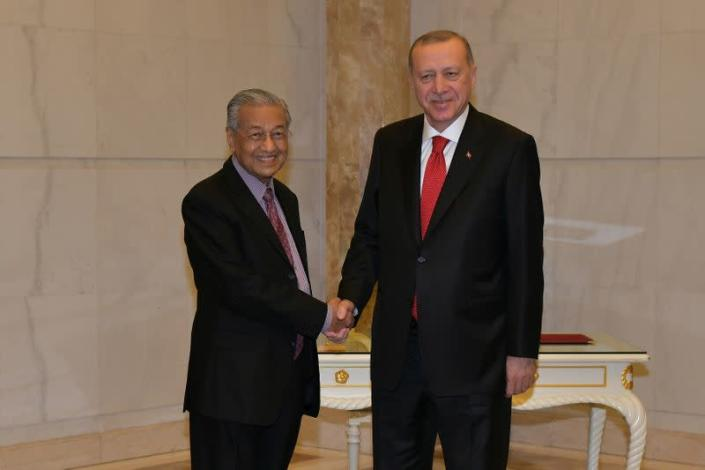Malaysia's Prime Minister Mahathir Mohamad shakes hands with Turkey's President Recep Tayyip Erdogan at Prime Minister Office in Putrajaya