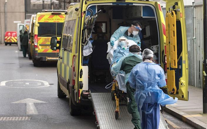 A patient is taken to an ambulance outside the Royal London Hospital in London during England's third national lockdown  - Ian West/PA