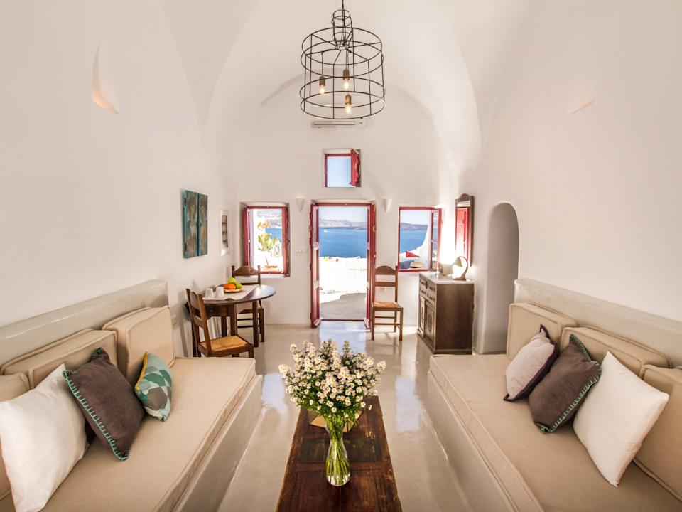 Interior shot of an historic cave house overlooking the sea in Santorini, Greece