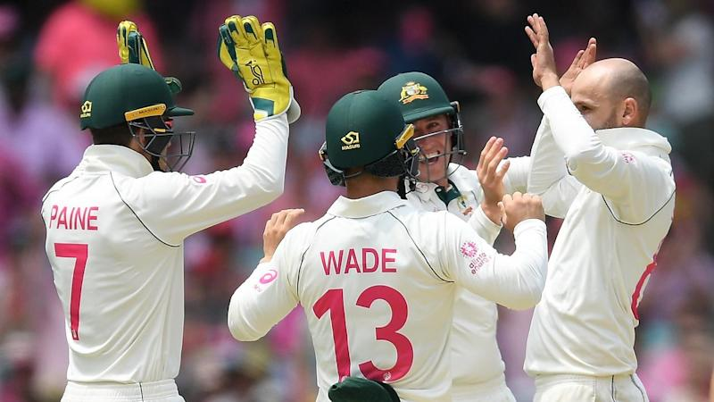Nathan Lyon (2R) has bagged five wickets for Australia who've dismissed New Zealand for 251
