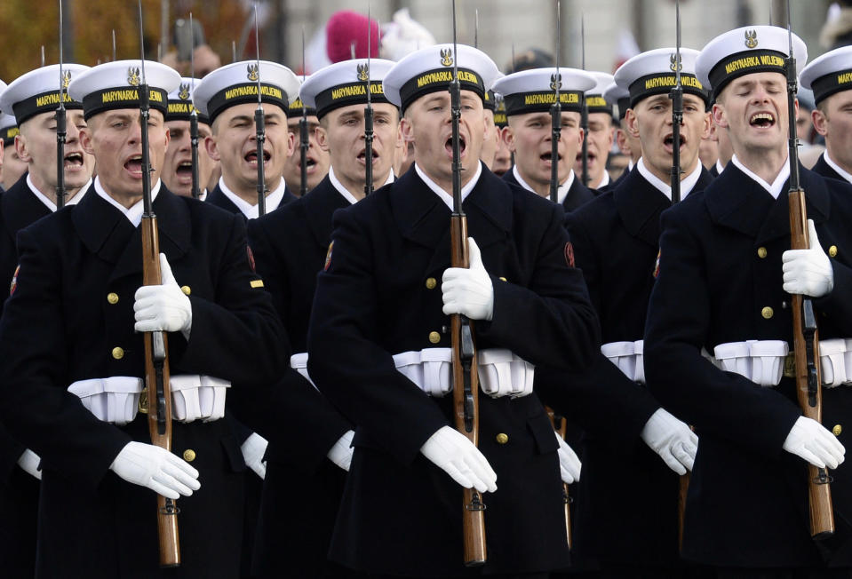 FILE - In this file photo taken Aug.15, 2017 Polish Navy troops stand at attention during the official ceremony marking Poland's Independence Day, in Warsaw, Poland. Defense Minister Mariusz Blaszczak says Poland will boost its military presence in the east with the formation of a new division of the armed forces. (AP Photo/Alik Keplicz,file)