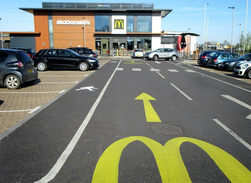 Cars queue outside one of the McDonalds restaurants. Burger chain McDonald's announces the closure of all 1,270 of its restaurants in the UK by the end of today as fears over the spread of coronavirus. (Photo by Keith Mayhew / SOPA Images/Sipa USA)