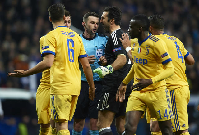 "Juventus goalkeeper Gianluigi Buffon was given a red card for his protests of <a class=""link rapid-noclick-resp"" href=""/ncaaf/players/251093/"" data-ylk=""slk:Michael Oliver"">Michael Oliver</a>'s decision to award <a class=""link rapid-noclick-resp"" href=""/soccer/teams/real-madrid/"" data-ylk=""slk:Real Madrid"">Real Madrid</a> a late penalty. (Getty)"