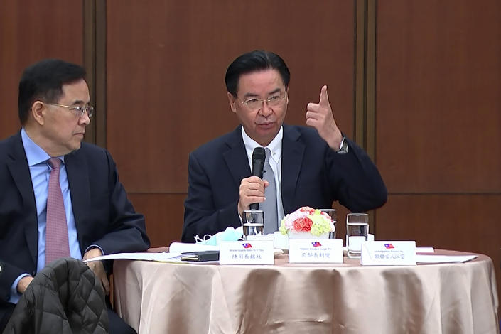 """Taiwanese Foreign Minister Joseph Wu, right, speaks during a briefing Wednesday, April 7, 2021, in Taipei, Taiwan. Wu said that China's attempts at conciliation and military intimidation are sending """"mixed signals"""" to people on the island China claims as its own territory to be won over peacefully or by force. (AP Photo/Wu Taijing)"""