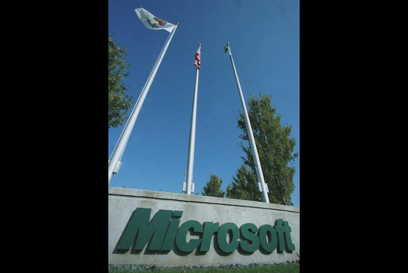 FILE - This set of flagpoles sits at one of the entrances to Microsoft Corporation in Redmond, Wash., in this Oct.19, 1998 file photo. The General Court of the European Union has upheld most of a massive fine against Microsoft Corp. by the European Commission's competition watchdog in 2008. In a ruling Wednesday, June 27, 2012, it rejected Microsoft's appeal but did cut the fine by €39 million to €860 million ($1.1 billion). (AP Photo/Joe Brokert, File)