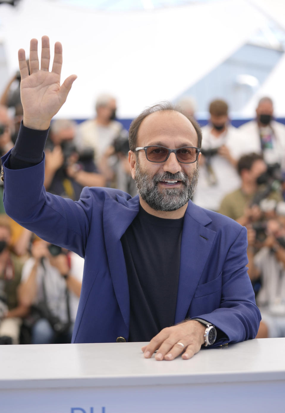 Director Asghar Farhadi poses for photographers at the photo call for the film 'A Hero' at the 74th international film festival, Cannes, southern France, Wednesday, July 14, 2021. (AP Photo/Vadim Ghirda)