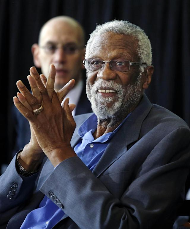 Former Boston Celtics basketball player Bill Russell applauds during a ceremony honoring him after a statue was unveiled at City Hall Plaza in Boston, Friday, Nov. 1, 2013. (AP Photo/Elise Amendola)