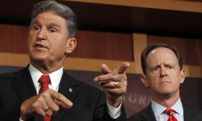 Sens. Joe Manchin and Pat Toomey, co-sponsors of a measure to expand background checks.