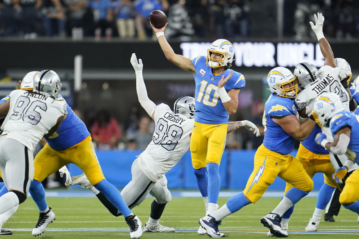 Los Angeles Chargers quarterback Justin Herbert (10) throws a pass during the first half of an NFL football game against the Las Vegas Raiders, Monday, Oct. 4, 2021, in Inglewood, Calif. (AP Photo/Marcio Jose Sanchez)