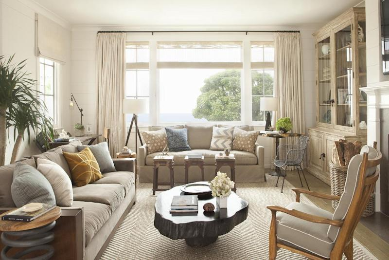 This interior design image released by Lucas Studio, Inc. shows a living room. The sun-drenched colors and windswept beachfront textures of summer provide ample inspiration for indoor decorating. Done wrong, a summer-inspired interior can be a tacky, overly tropical disaster. But with a light touch and careful choices, summer can provide ideas for an interior you'll love all year long. (AP Photo/Lucas Studio, Inc., Karyn Millet)