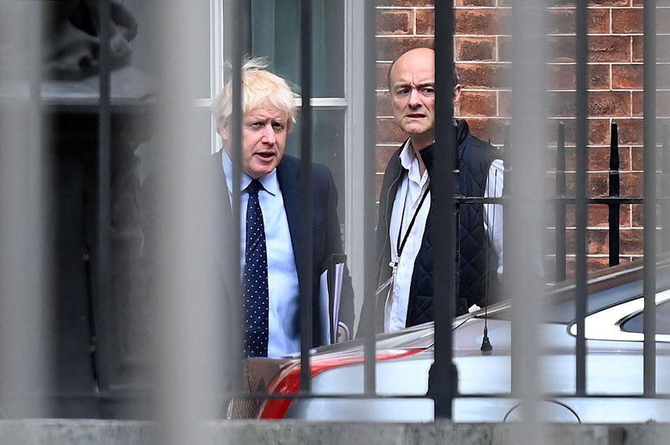 <p>The prime minister and Dominic Cummings when he was Mr Johnson's chief adviser</p> (AFP via Getty)