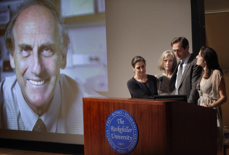 Nobel prize winner Ralph Steinman's family, from left to right, daughter Lesley Steinman, wife Claudia Steinman, son Adam Steinman and daughter Alexis Steinman, speak at a ceremony honoring him at Rockefeller University in New York, Monday, Oct. 3, 2011. Ralph Steinman, a cell biologist, was awarded the Nobel Prize in medicine on Monday for his discoveries about the immune system but hours later his university said that he had been dead for three days. The Nobel committee had been unaware of Canadian-born Ralph Steinman's death. (AP Photo/Seth Wenig)