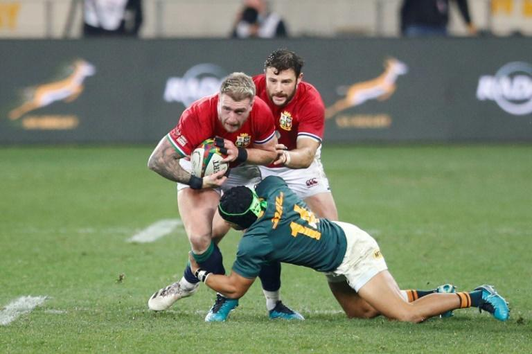 British and Irish Lions full-back Stuart Hogg (L) is tackled by South Africa winger Cheslin Kolbe (R) during the second Test in Cape Town on Saturday