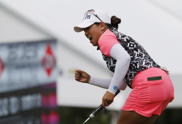 Jasmine Suwannapura reacts after a birdie putt on the 15th green during the final round of the Dow Great Lakes Bay Invitational golf tournament, Saturday, July 20, 2019, in Midland, Mich. (AP Photo/Carlos Osorio)
