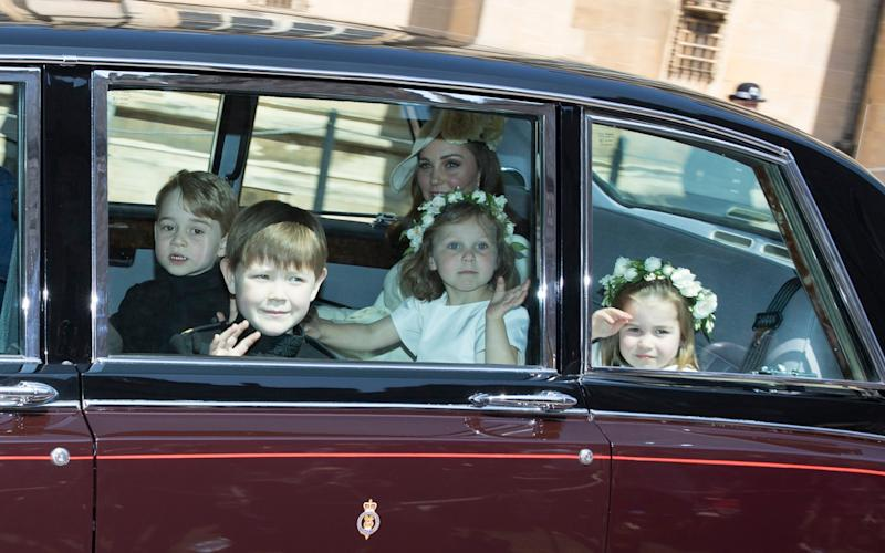 The troop of bridesmaids and pageboys were kept under control by Maria Borrallo - .