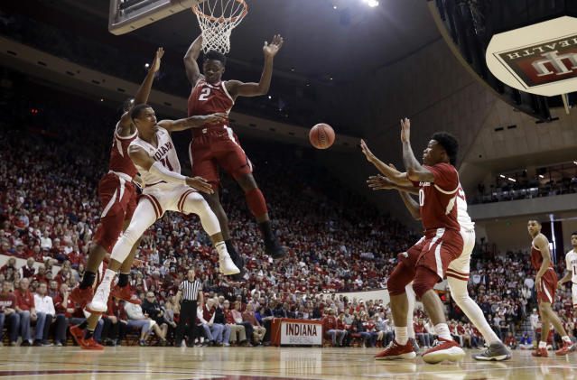 Indiana's Devonte Green (11) makes a pass against Arkansas's Adrio Bailey (2) during the second half in the second round of the NIT college basketball tournament, Saturday, March 23, 2019, in Bloomington, Ind. Indiana won 63-60. (AP Photo/Darron Cummings)
