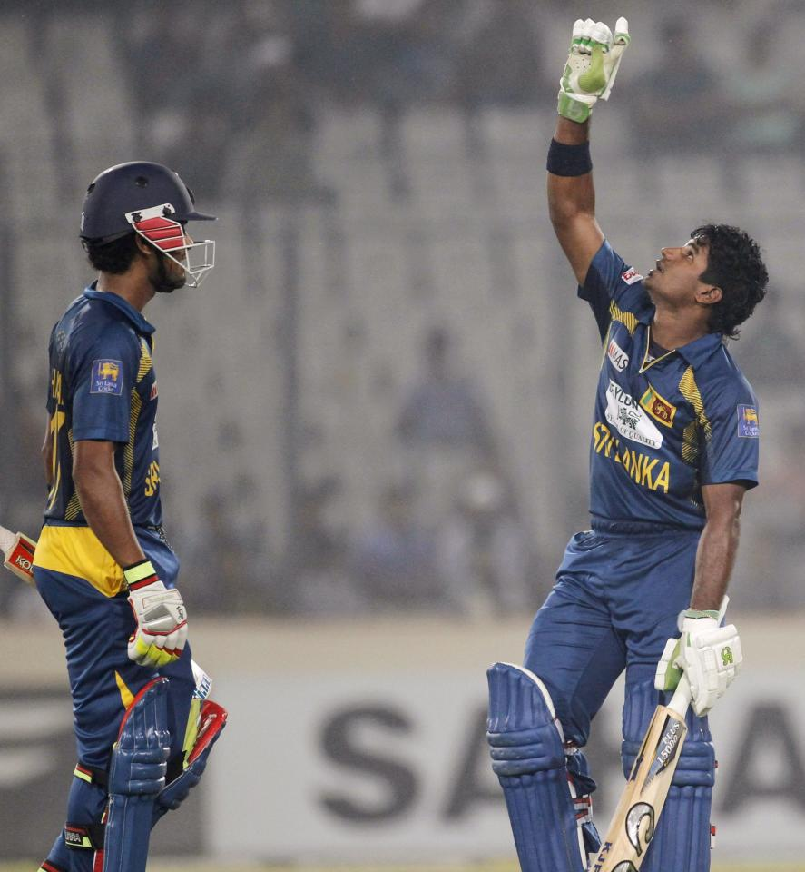 Sri Lanka's Kusal Perera (R) celebrates scoring a century against Bangladesh during their third one day international (ODI) cricket match of the series in Dhaka February 22, 2014. REUTERS/Andrew Biraj (BANGLADESH - Tags: SPORT CRICKET)