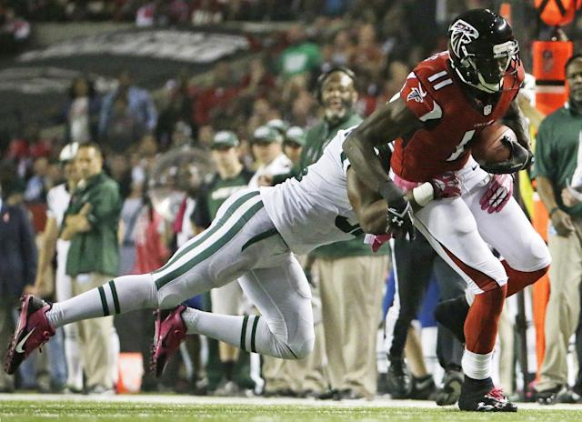 Atlanta Falcons wide receiver Julio Jones (11) runs the ball after a catch against New York Jets defensive back Josh Bush (32) during the first half of an NFL football game, Monday, Oct. 7, 2013, in Atlanta. (AP Photo/David Goldman)
