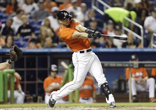 FILE - In this Sept. 11, 2013 file photo, Miami Marlins' Justin Ruggiano bats during a baseball game against the Atlanta Braves, in Miami. The Chicago Cubs obtained the right-handed outfield bat they needed, acquiring Ruggiano from the Miami Marlins for lefty swinging Brian Bogusevic. (AP Photo/Lynne Sladky, File)