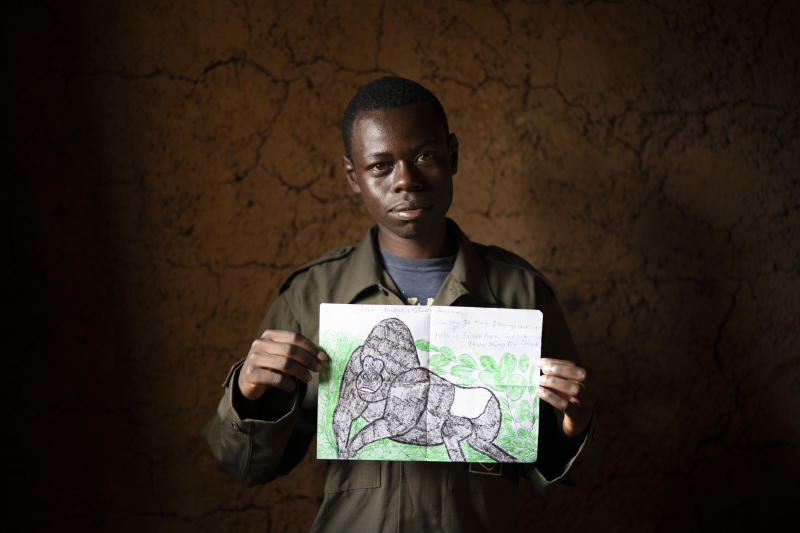 Jean Claude Masengesho holds one of his many drawings of silverback gorillas in Kinigi, Rwanda. (Photo: Felipe Dana/AP)
