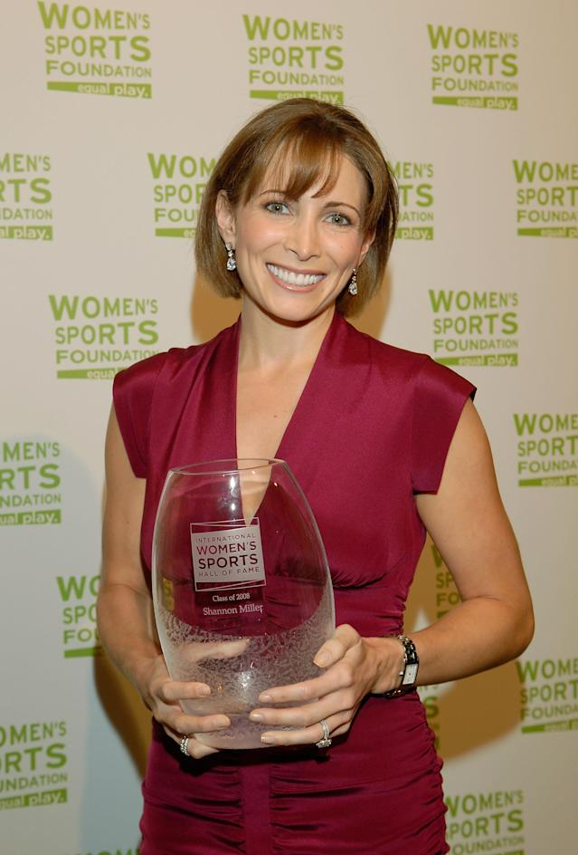 NEW YORK - JUNE 9: Olympic gymnastics star Shannon Miller poses with her award prior to be inducted into the International Women's Sports Hall of Fame at the Sports Museum of America June 9, 2008 in New York City. (Photo by Jonathan Fickies/Getty Images for Women's Sport Foundation)