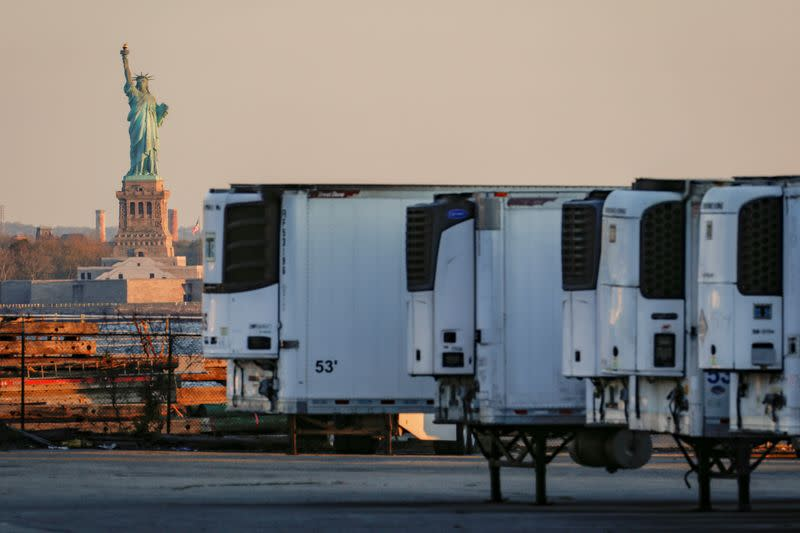 FILE PHOTO: Refrigerated tractor trailers used to store bodies of deceased people are seen at a temporary morgue in Brooklyn, New York