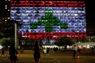 The municipality building is lit in the colours of the Lebanese flag in Tel Aviv
