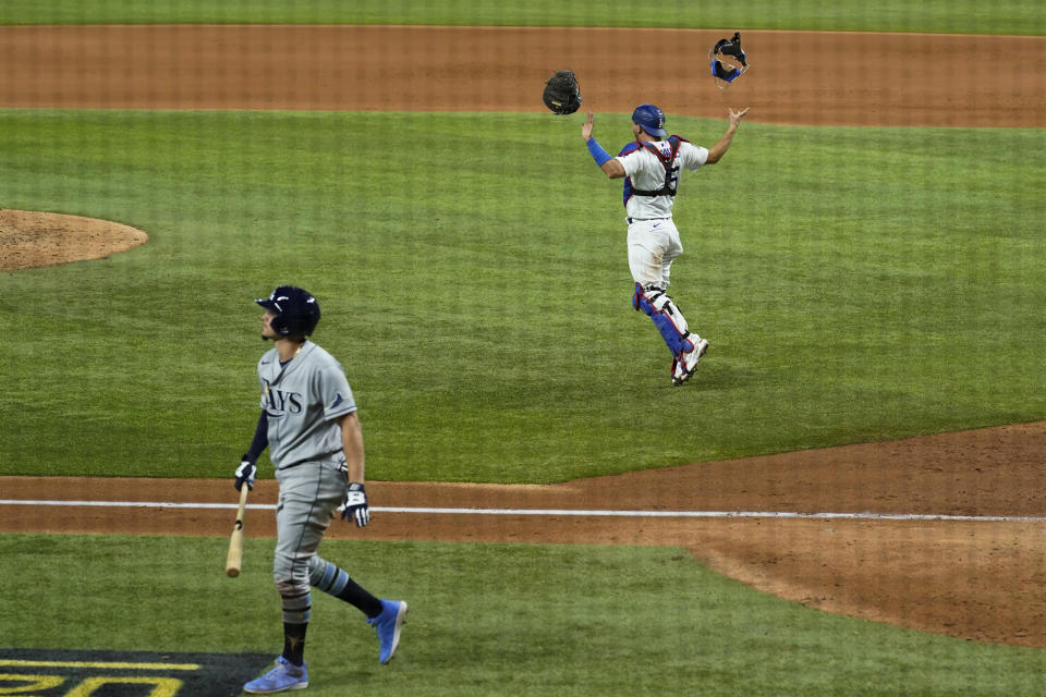 Los Angeles Dodgers catcher Austin Barnes celebrates the final out by Tampa Bay Rays' Willy Adames to win the baseball World Series in Game 6 Tuesday, Oct. 27, 2020, in Arlington, Texas. (AP Photo/David J. Phillip)