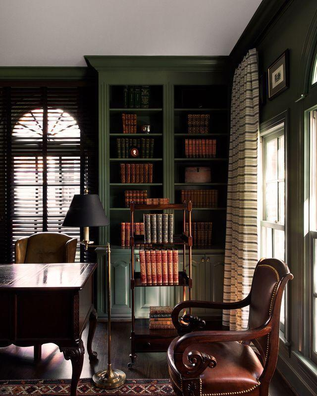 """<p>Consider painting your cabinets and bookcases, like in this <a href=""""https://www.elledecor.com/design-decorate/house-interiors/a35889237/lily-dierkes-nashville/"""" rel=""""nofollow noopener"""" target=""""_blank"""" data-ylk=""""slk:moody library"""" class=""""link rapid-noclick-resp"""">moody library</a> designed by <a href=""""https://lilydierkesdesign.com/"""" rel=""""nofollow noopener"""" target=""""_blank"""" data-ylk=""""slk:Lily Dierkes"""" class=""""link rapid-noclick-resp"""">Lily Dierkes</a>. The dark green cabinets against dark wooden floors and furniture create a perfect atmosphere for curling up with a book on a chilly evening. </p>"""