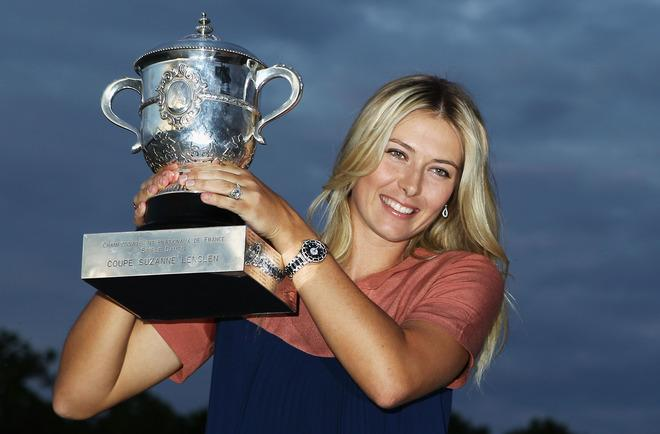 PARIS, FRANCE - JUNE 09:  French Open women's champion Maria Sharapova of Russia poses with the Coupe Suzanne Lenglen near the Eiffel Tower after her victory earlier in the day in the women's singles final against Sara Errani of Italy during day 14 of the French Open at Roland Garros on June 9, 2012 in Paris, France.  (Photo by Matthew Stockman/Getty Images)