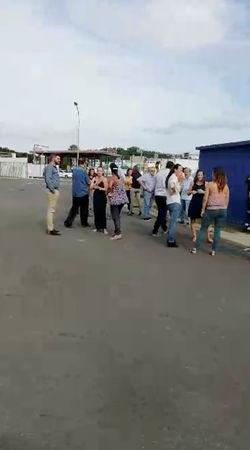 People gather outside during a quake evacuation in Noumea