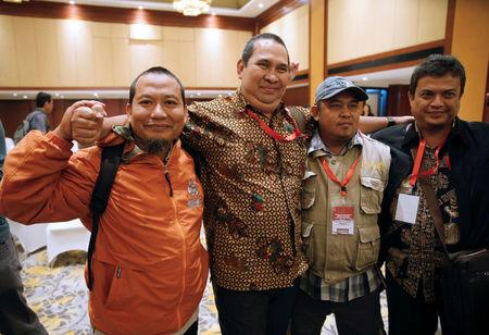 (L-R) Former Indonesian militant Toni Togar, Sarinah Jakarta bomb victims Denny Mahieu, former militant Ramses and Ramli pose for a photo after a meeting between former militants and victims in Jakarta, Indonesia, February 28, 2018. REUTERS/Beawiharta