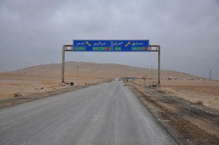 A road sign that shows the direction to the Syrian city of Palmyra is pictured on the edge of the city, March 2, 2017. SANA/Handout via REUTERS