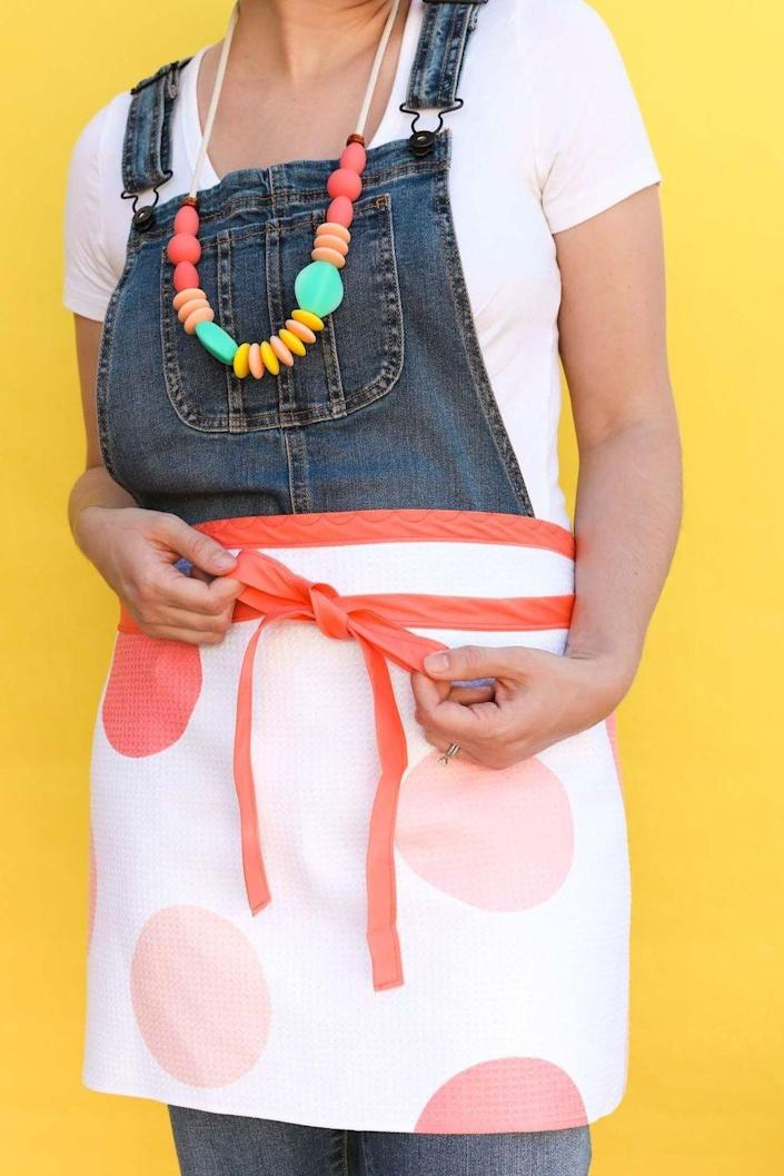 """<p>We can't get over how easy it is to create this DIY apron. It's as sophisticated as a store-bought one would be but packed with more love. </p><p><strong>Get the tutorial at <a href=""""https://sarahhearts.com/tea-towel-aprons/"""" rel=""""nofollow noopener"""" target=""""_blank"""" data-ylk=""""slk:Sarah Hearts"""" class=""""link rapid-noclick-resp"""">Sarah Hearts</a>.</strong></p><p><strong><a class=""""link rapid-noclick-resp"""" href=""""https://go.redirectingat.com?id=74968X1596630&url=https%3A%2F%2Fwww.walmart.com%2Fip%2FLinteum-Textile-2-Pack-28x32-in-Green-KITCHEN-CHEF-BIB-APRON-Commercial-Grade-for-Restaurants-Home-Use%2F217421760&sref=https%3A%2F%2Fwww.thepioneerwoman.com%2Fholidays-celebrations%2Fgifts%2Fg32307619%2Fdiy-gifts-for-mom%2F"""" rel=""""nofollow noopener"""" target=""""_blank"""" data-ylk=""""slk:SHOP APRONS"""">SHOP APRONS</a><br></strong></p>"""
