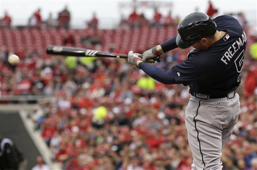 Atlanta Braves' Freddie Freeman (5) hits a one-run single off Cincinnati Reds starting pitcher Bronson Arroyo in the first inning of a baseball game, Monday, May 6, 2013, in Cincinnati. (AP Photo/Al Behrman)