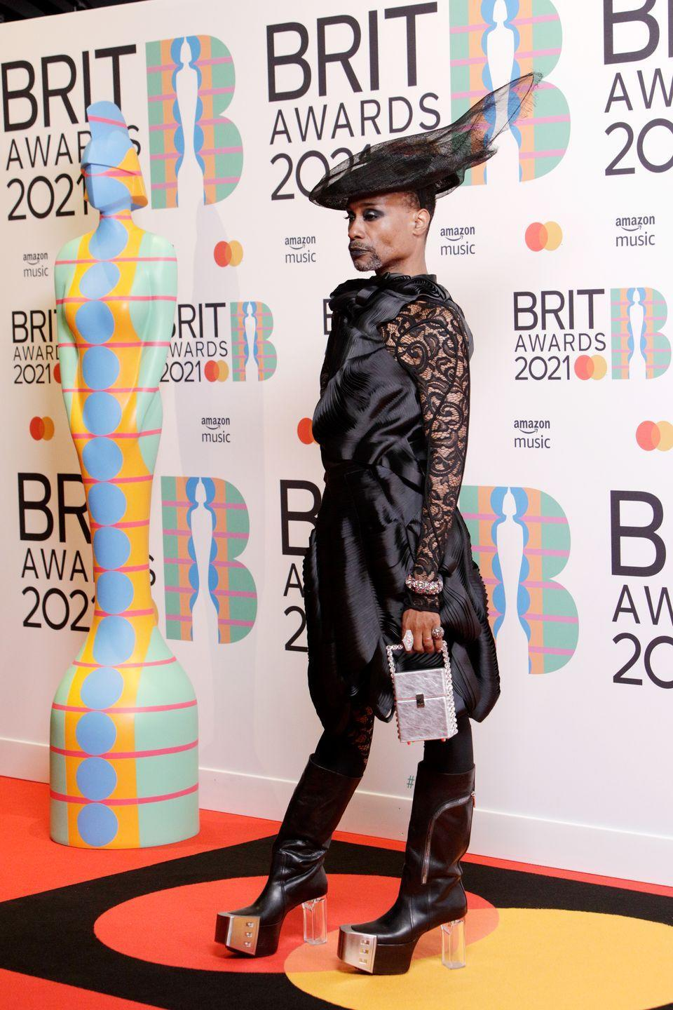 <p>The star wore an all-black ensemble to the BRIT Awards in London. The outfit consisted of a threeASFOUR dress and trouser combination, a hat by Stephen Jones Millinery, Lorraine Schwartz jewellery and Rick Owens shoes. </p>