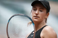 Belarus's Victoria Azarenka looks at her racquet as she played against Russia's Anastasia Pavlyuchenkova during their fourth round match on day 8, of the French Open tennis tournament at Roland Garros in Paris, France, Sunday, June 6, 2021. (AP Photo/Thibault Camus)