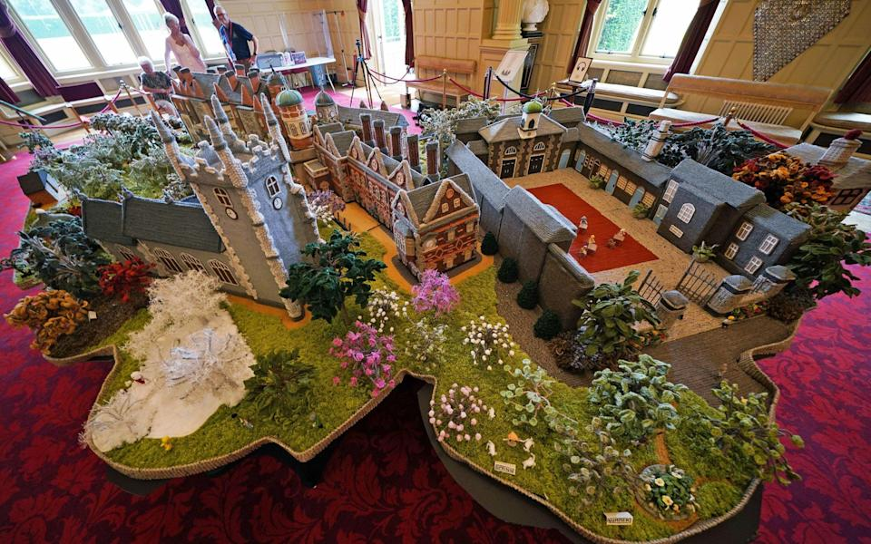 As well as the knitted Sandringham House, the model - which has taken two years to complete - features St Mary Magdalene Church, stables and the Nest Summer House - PA